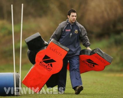Coach carrying tackle pads